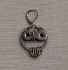 Owl earrings made from recycled bike parts