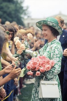 Queen Elizabeth II looked incredibly lovely during this visit to the U.S. in 1976, decked out in femme #florals and dainty details, like a chain of pearls and structured handbag. Of course, she topped it all off with a charming hat #refinery29