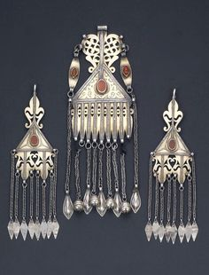 Central Asia | Gilded silver and carnelian pair of temporal ornaments and one pendant | 20th century