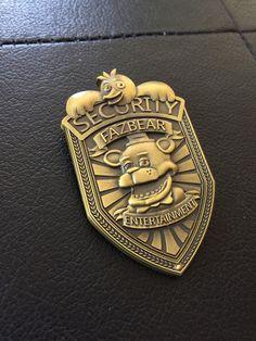 buy on ebay for 29.68 + 4.22  link here: http://www.ebay.com/itm/Five-Nights-At-Freddys-Fazbear-Security-Badge-Pin-Antique-Bronze-Plated-FNAF-/111615094552?pt=LH_DefaultDomain_0&hash=item19fcc72f18
