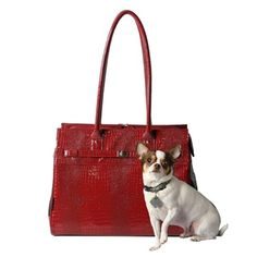 Embossed Patent Croco Monaco Pet Tote in Merlot from SimplyDogStuff.com is a modern classic with timeless appeal for taking your furbaby along with you wherever you go.  $55.98            Removable interior leash strap   Two fur friendly mesh panels for ventilation.   Comfortable over the shoulder handle                 For pets up to 12 long nape to tail  7 high nape to floor, up to 8 po