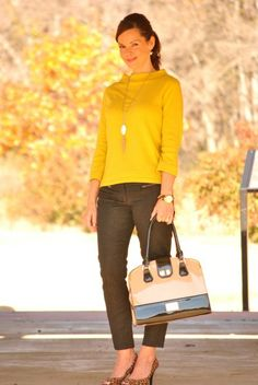 Holiday party outfit, yellow sweater, black plants, leopard heels.