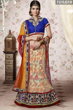 Cream net lehenga adorned with stone, zari, resham embroidery, floral print and lace work with red velvet patch border. Blue art silk choli and red, yellow net dupatta are available with this.Price US$ 154