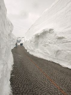 St. Gotthard Pass in Ticino, Switzerland ( o how I remember this road with the snow while wearing shorts for vacation time!)