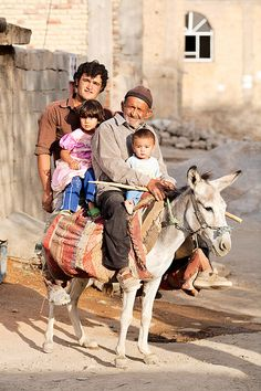An elderly man, a young man, a small girl and an infant sit on a grey donkey. Photo taken on August 2007 in Kaj, Chaharmahal and Bakhtiari Province, Iran. We Are The World, People Around The World, Wonders Of The World, Around The Worlds, Real People, Naher Osten, Teheran, Bagdad, Elderly Man