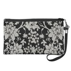 Black and silver dust floral pattern wristlet purse