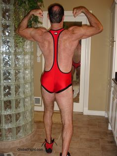 older irish bodybuilder flexing big arms