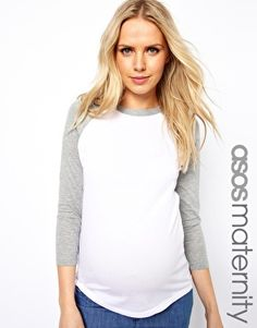 I'm at 35 weeks, and the ASOS tees fit really well.  Haven't bought this one yet, but might get it soon.