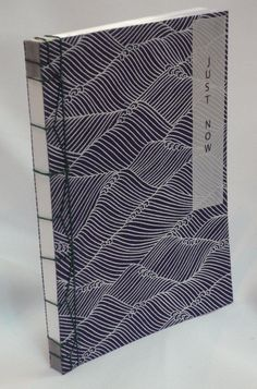 beautiful traditional japanese stab binding by Persimmon Paperworks with navy and white waves covers