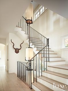 To make all three levels of the house flow together, Martin and architect Brad Sturman designed an open metal staircase that encompasses Martin's custom light fixture. Both were executed by Santa Barbara metal artist Mick Handley. Modern Staircase Railing, Iron Staircase, Iron Stair Railing, Staircase Railings, Staircase Design, Stairways, Staircase Ideas, Banisters, Wrought Iron Stairs