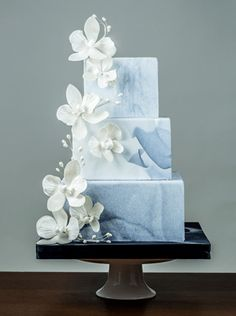 IDC-268 From I Do! Wedding Cakes. Would be nice with lily of the valley and white tulip sugar flowers and grey marble.