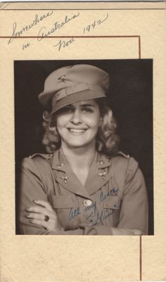 An American nurse in Australia (November 1942). Her expression, hairstyle, body language, and the jaunty angle of her cap combine to project a remarkably contemporary look and feel.