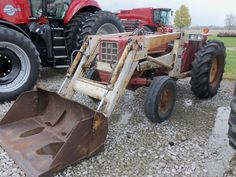The 2nd International Harvester 574 with white 2050A  loader