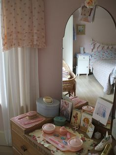 My mom and dad's bedroom set had a similar vanity - only with a big round mirror!