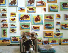 David Hockney with his two dachshunds, Stanley and Boodgie. On the wall behind him dozens of Dachshund portraits....