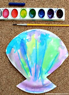 an Ocean Playdate! Watercolor Seashell Art Project for Preschoolers. Host an Ocean Themed Playdate with toddlers or preschoolers. 4 easy activities that encourage children to learn and play oceans!Activity Activity may refer to: Beach Themed Crafts, Ocean Crafts, Preschool Beach Crafts, Toddler Summer Crafts, Beach Crafts For Kids, Water Themed Crafts, Preschool Summer Theme, Summer Crafts For Preschoolers, Summer Crafts For Toddlers