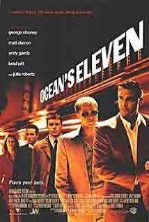 George Clooney, Brad Pitt, Julia Roberts. Director: Steven Soderbergh. IMDB: 7.7  _________________________ http://en.wikipedia.org/wiki/Ocean%27s_Eleven http://www.rottentomatoes.com/m/oceans_eleven/ http://www.metacritic.com/movie/oceans-eleven http://www.tcm.com/tcmdb/title/420294/Ocean-s-Eleven/