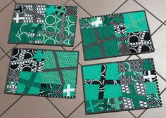 Emerald, black, & white placemats by flickrdeb50, via Flickr