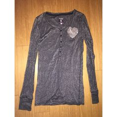 RARE!!!! Victoria's Secret Henley top Hard-to-find( LIMITED EDITION) Victoria's Secret Pink metallic Henley Top in excellent pre-owned condition. . Dark gray, almost black. Like new, no visible signs of wear. Bling rhinestone detail, all rhinestones still in tact. SUPER COMFY!!!!! Victoria's Secret Tops Tees - Long Sleeve