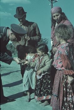 Oberfeldfebel Luftwaffe gives coin gypsy girl on the island of Crete.