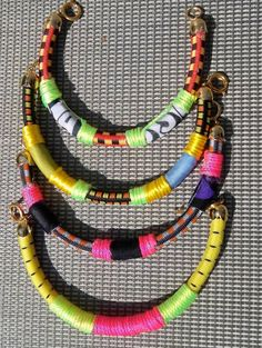 Set of 3 Bangles, Bungee Cord Bracelets with Neon Details and Gold Plated Findings. $39.00, via Etsy.