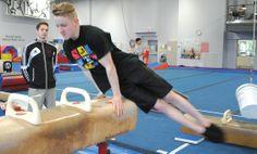 Bradley Gulbranson (Delta) works out on the pommel horse under the watchful eye of coach Tyson Arner in preparation for this week's Canadian Gymnastics Championships in Ottawa. [Delta Optimist]