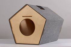 Unique hand-made by the studio HolinDesign pet-house for cat. This hut may serve as a carrier. House is made of birch plywood lacquered with shellac,