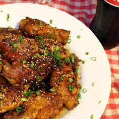 Coca Cola Chicken Wings with Chicken Wings, Soy Sauce, Sherry Vinegar, Coca Cola, Green Onions, Toasted Sesame Seeds, Vegetable Oil.