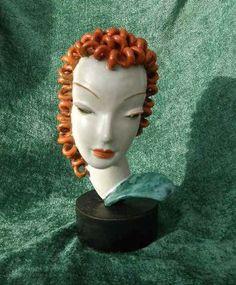 Terracotta bust by Goldscheider Goldscheider freestanding bust on a wooden base, designed by Rudolf Knorlein in 1932.