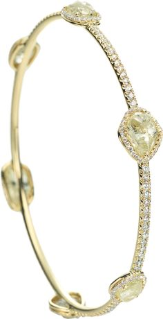Orielle bangle bracelet featuring six rough diamonds totaling 20.43cts accented with 2.28cts of micro pavé diamonds in 18k yellow gold.