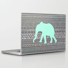 awesome site for wall art, iphone, ipad, laptop cases, shirts, etc. Mint Elephant  Laptop & iPad Skin