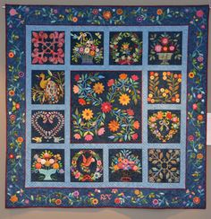 """""""Spring Has Sprung in Baltimore"""", hand appliqued by Rita O'Connor.  This quilt was begun as a block-of-the-month class taught by Joanne Parks. Center medallion adapted by Rita from a single block pattern. Border design by Rita and her daughter, Eileen Heins. Machine quilting by Donna Derstadt."""