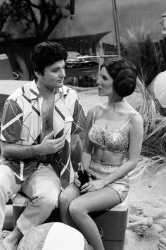 Bill Murray woos Princess Leia at the beach.