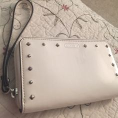 Coach wallet/ wristlet White studded, leather coach wallet. Has a small stain on the back from denim because i would keep it in my back pocket. Coach Bags