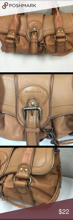 BCBG GIRLS Tan leather handbag double handles Beautiful tan double handle straps flap with magnetic snap close. Buckle detail. It's in great condition with one small blemish on the flap underside where the copper is pulled up. BCBGirls Bags Shoulder Bags