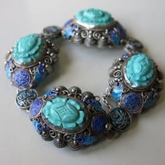 A Chinese carved Turquoise silver and enamel bracelet.