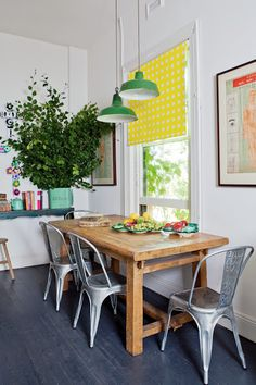 Bright yellow blinds, metal chairs, dining table in hood