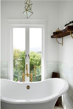 gorgous simple bath with open tub and faceted pendant | california style on coco kelley