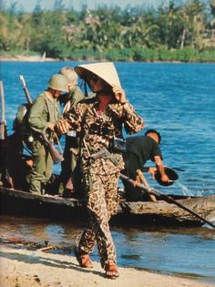 ARVN ranger with retro camo uniform, sunglasses, binoculars, a view finder camera, a '45 stuck in his waist, sandals and a straw hat.