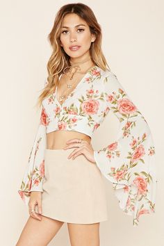 A crop top featuring an allover floral print, plunging V-neckline, crisscross straps that tie in back, a button accent in front, and long bell sleeves. Fashion Walk, Cute Fashion, Girl Fashion, Fashion Outfits, Womens Fashion, Bell Sleeves, Bell Sleeve Top, Cool Outfits, Summer Outfits