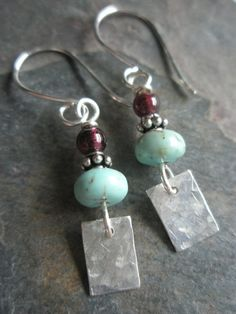 Bright spots of pale blue turquoise rondelles join small garnet beads and sterling silver hammered charms to create these light weight, dainty dangles. Beaded Jewelry Designs, Bead Jewellery, Metal Jewelry, Garnet Earrings, Beaded Earrings, Etsy Earrings, Argent Sterling, Sterling Silver, Unique Earrings