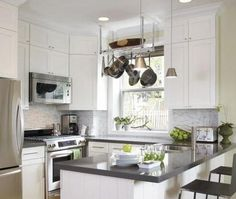 Suzie: House & Home - Small efficient kitchen design with white kitchen cabinets, gray quartz ...