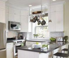 white kitchen cabinets, gray quartz countertops, marble backsplash