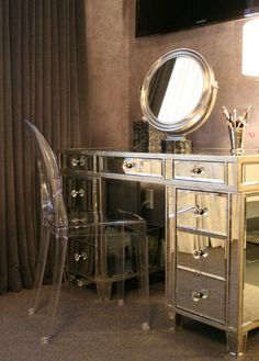 Just did a very similar install at a clients...mirrored dresser with lucite chair. Perfect space to pamper yourself!