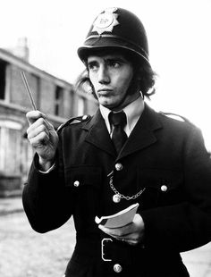 Liverpool footballer Kevin Keegan dressed up as a policeman including bobby's helmet November 1972