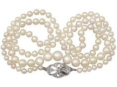 Single Strand Pearl Necklace with 0.25ct Diamond, 9ct White Gold Clasp - Antique & Vintage SKU: A2785 Price GBP £1,395.00 http://www.acsilver.co.uk/shop/pc/Single-Strand-Pearl-Necklace-with-0-25ct-Diamond-9ct-White-Gold-Clasp-Antique-Vintage-35p8131.htm