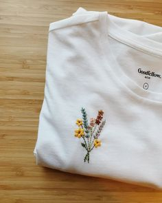 Made to order hand embroidered tshirt with flower bouquet over pocket Indian Embroidery Designs, Embroidery On Clothes, Embroidery Flowers Pattern, Embroidered Clothes, Hand Embroidery Patterns, Embroidery Stitches, T Shirt Embroidery, Pattern Flower, Folk Embroidery