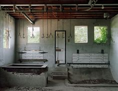 Slaughterhouse - Broughton State Hospital, North Carolina Abandoned Slaughterhouse, Abandoned Hospital From the book Asylum by Christopher Payne Can anyone tell me why there's a slaughterhouse in a...
