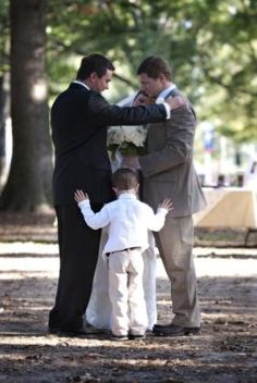 pastor praying with us before the ceremony and the ring bearer, who is his son, just walked up and joined in. so precious.