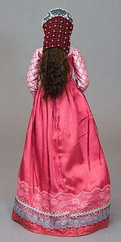 Isabella: Ensemble includes: slip, under-dress, over-dress, headdress, necklace